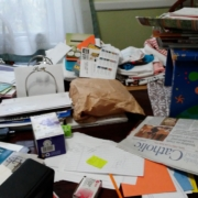 pile of papers on table